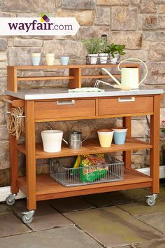 This potting bench is designed for outdoor entertainment and features an abundance of storage for your gardening needs. Save up to 70% off at Wayfair!