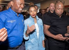 Singer and Mayor Sylvester Turner meet with evacuees in affected neighborhoods