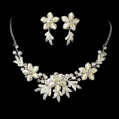 Silver White Snowflake Jewelry Set. Kim's Bridal, Keywords:  #michiganeventrentals #michiganbridalshop #weddingrentals #weddingaccessories #kimsbridal Follow Us: http://www.kimsgiftbaskets.com/ ... https://www.facebook.com/KimsGifts