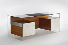 Desk by  Philippon and Lecoq. 1967. Glass, wood, white laminate. 483 cm x 208 cm x 190.5 cm. Courtesy of Demisch Danant.