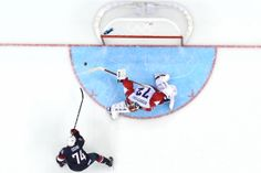 Feb. 15, 2014. T.J. Oshie of the United States shoots during a shootout against Sergei Bobrovski of Russia during the Men's Ice Hockey Preli...