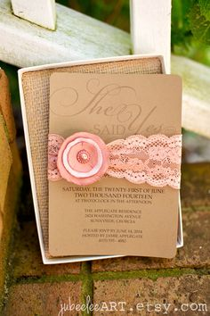 "Blush tones/coral. ""She said yes""  bridal shower invitation on kraft paper with tea stained lace and paper flower belly band. Can be converted to wedding invitation or save the date."