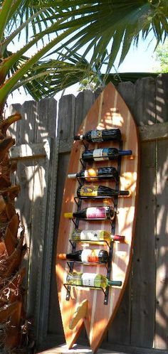 Surfboard Wine Rack, could use any type of board...Danielle I thought of you when I saw this.