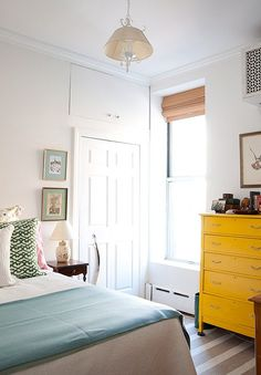 perfectly cheerful color combination / design*sponge - white room with bright yellow dresser Estilo Interior, Home Interior, Modern Interior, Style At Home, Apartment Living, Apartment Therapy, Home Bedroom, Bedroom Decor, Calm Bedroom