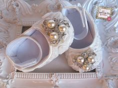 these are the cutest things ever!   Baby Girl  white Satin Rosette Crib Shoes  by TheBabyBellaBoutique, $21.90