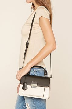 A structured faux leather satchel featuring a flap top with a high-polish snap-buckle closure, one front exterior pocket, an adjustable shoulder strap, and two interior compartments.
