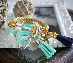 Handmade cord bracelets with tassels and anchor