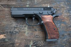 CZ P-01 with sexy ass wood grips.Loading that magazine is a pain! Get your Magazine speedloader today! http://www.amazon.com/shops/raeind