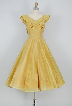 vintage 1950s golden organza dress; gathered bust; v neck collar; bow at back of collar; tulle petticoat underneath