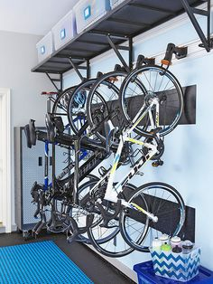 Keep bikes off the floor and give your garage more space by installing vertical bike racks. Keep bikes off the floor and give your garage more space by installing vertical bike racks. Garage Shed, Garage House, Garage Workshop, Garage Bike Storage, Small Garage, Dream Garage, Workshop Ideas, Bike Racks For Garage, Garage Doors
