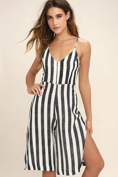 The Even Better Black and White Striped Midi Jumpsuit is more stylish than we could have ever imagined! Gauzy, black and white striped woven fabric, falls from adjustable straps, into a princess-seamed bodice and attached culotte pant legs, with side slits. V-back with tying accent. Hidden side zipper/clasp. As Seen On Hannah of @hannah_rathbunn!