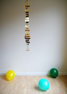 super simple DIY gold garland: cut strips of paper, sew down the middle with your sewing machine, hang, done!  {Hank and Hunt}