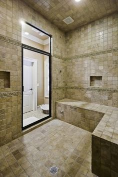 This HUGE shower was done in all Noce Travertine, with Steam Shower built in as well as two shower heads.