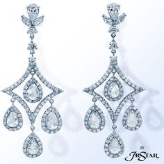JB Star Exquisite chandelier earrings meticulously crafted in pure platinum feature 8 Pear-Shaped Rose Cut diamonds with pavé edging, suspended by pear sapped diamonds.