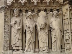 Notre Dame Cathedral: St. Denis.  Strange gesture of the angel trying to comfort the Saint holding his own head.