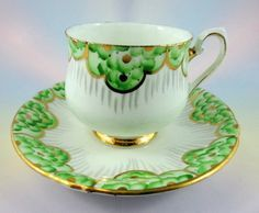Unusual Phoenix Lime Green Gold Design Tea Cup and Saucer