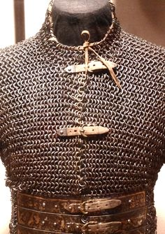I love this idea of the chain mail shirt with the leather waist brace with buckles. Could definitely be the daily guard wear for the Dragons.