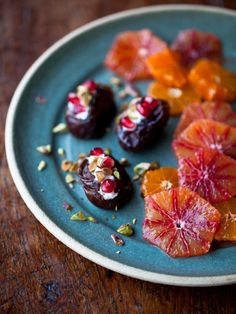 a simple zuni dessert - dates stuffed with mascarpone, pomegranate, pistachios + mandarines, blood oranges and a splash of orange blossom water