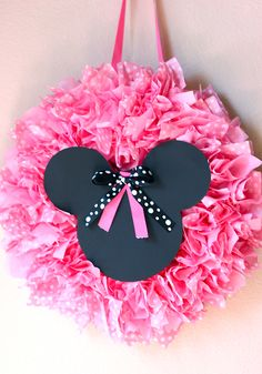 Throwing a Minnie Mouse birthday party--Why not greet your guests with this cute little Minnie Mouse wreath on the front door.