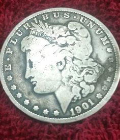 Check out this item in my Etsy shop https://www.etsy.com/listing/556186653/1901-o-morgan-silver-dollar