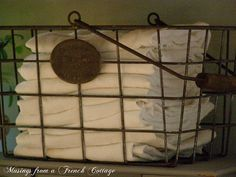 linen in a wire basket, I have all my Tea towels in the kitchen in a wire basket similar to this one, I love the effect.