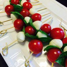 Cherry tomatoe basil and mini mozzarella on bambue stick.