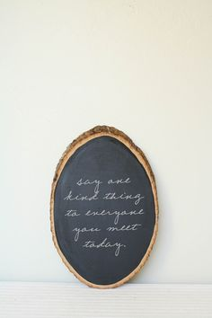 """say one kind thing to everyone you meet today"" love the chalkboard wood"