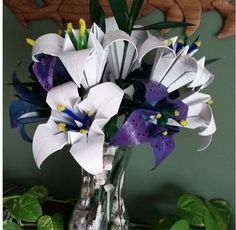 I made these origami seed bouquets a couple of years ago as mothers day gifts.  They took a little time but are simple enough once you know how to fold the flow…