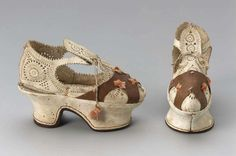 Children's or sample shoes, punched alum-tanned leather with brown leather over vamp, stitched with pink silk with silk cords and tassels, heel and platform of unspecified material covered with alum-tanned leather with leather sole, 1610-20, Italian.