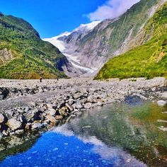 There beautiful Franz Josef Glacier in New Zealand. This was one of our first stops when we arrived and it was one super intense hike!