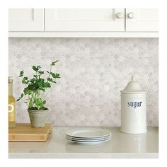 Get the look of an intricate tile backsplash with these peel and stick panels! The small hexagon tiles have the look of classic Carrara marble. Hexagon Marble Peel and Stick Backsplash contains 4 pieces on 4 sheets that measure 10 x 10 inches. Self Adhesive Backsplash Tiles, Hexagon Tile Backsplash, Peel Stick Backsplash, White Kitchen Backsplash, Peel And Stick Tile, Stick On Tiles, Wallpaper Backsplash Kitchen, Hexagon Tiles, Kitchen Splashback Ideas