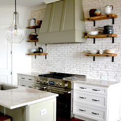 Enjoy the genuine look of Old Chicago brick in an easy-to-install siding with Old Chicago Blanc Manufactured Stone Siding by Koni Materials. This popular style of brick is authentic and realistic Brick Tiles Kitchen, Painted Brick Backsplash, White Brick Tiles, Kitchen Redo, New Kitchen, Kitchen Remodel, Kitchen Design, Kitchens With Brick Backsplash, Kitchen With Brick