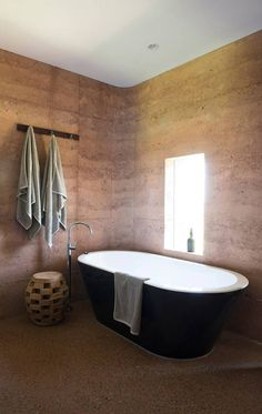 Australian firm Luigi Rosselli Architects have completed what they are calling the country's longest rammed earth wall, as part of a residence for seasonal workers on a cattle ranch. Gravel from the nearby river and water from the local well was used as a binder in these walls, and rammed by hand, creating a gorgeous, layered look characteristic to rammed earth walls. The floor is poured concrete slab, given the same colour by utilizing the same gravel and aggregates from the river.