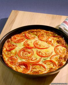 Zucchini & Tomato Frittata - Martha Stewart Serve this hearty egg dish at breakfast, lunch, or dinner. Zucchini Frittata, Zucchini Tomato, Zucchini Tart, Zucchini Casserole, Stuffed Zucchini, Vegetable Recipes, Vegetarian Recipes, Cooking Recipes, Healthy Recipes