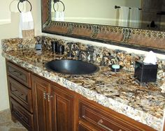 granite bathroom countertop with single-bowl sink