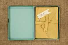 Bridal Shower Invitations by Antiquaria via Oh So Beautiful Paper teal and yellow boxed invites