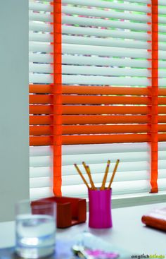 Luxury gloss white and orange wooden blinds with orange tapes.