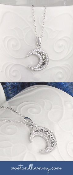 crescent moon necklace with ornate filigree design in sterling silver.