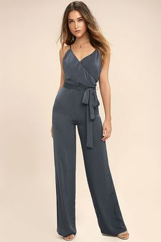 You'll always leave a lasting impression in the Got You On My Mind Navy Blue Jumpsuit! Luxurious woven fabric falls from adjustable spaghetti straps into a wrapping, surplice bodice. Fitted waist, with tying sash, sits above high-waisted, wide-leg pants. Hidden back zipper.