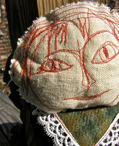 Primitive mommy and baby doll, red embroidered face.  New and vintage material.