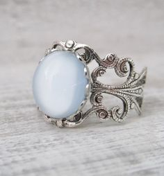 Etsy listing at https://www.etsy.com/listing/182331542/silver-blue-ring-blue-adjustable-ring