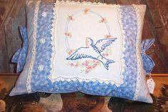 a bluebird pillow