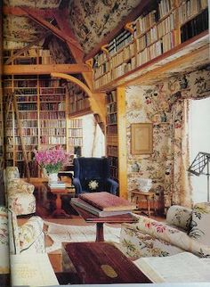 This rustic reading nook has a floor-to-ceiling wooden bookshelf and a hanging set above the picture window.