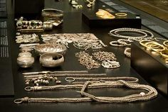 You can see the silver hoard and other hoards from the Viking Age in the exhibition about Danish Prehistory.The silver hoard from Terslev in Zealand contains 6.6 kg of silver, including 1751 coins. 1708 of the coins are of Arab origin. The latest-dated coin is from the year 944 and the hoard was buried in the second half of the tenth century. The objects are neck and arm rings, chains with toiletry accessories, costume jewellery and a drinking service.