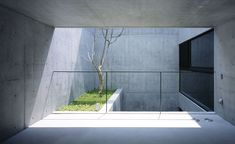 Its monolithic appearence is broken up by a central courtyard and a parking area carved out of the box volume