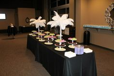 Feather table arrangements with dollar store created treat trays - Gateway Church Pink