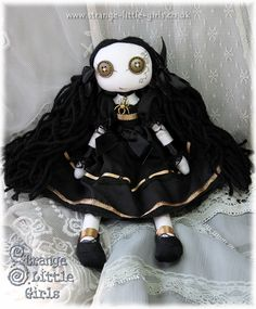 Custom Gothic Lolita cloth art doll with button eyes, in black and gold