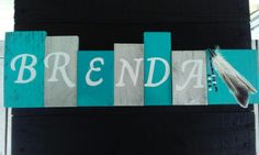 Name boards with various colors and designs. $25
