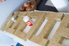DIY Glitter Letters - paper mache letters that are spray painted and covered with glitter. Easy and affordable project for your home or nursery!