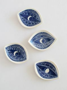 Sister Golden | Indigo Spirit Eye Dish –A hand-sculpted porcelain dish with carved graphic eye motifs perfect for displaying your favorite treasures.